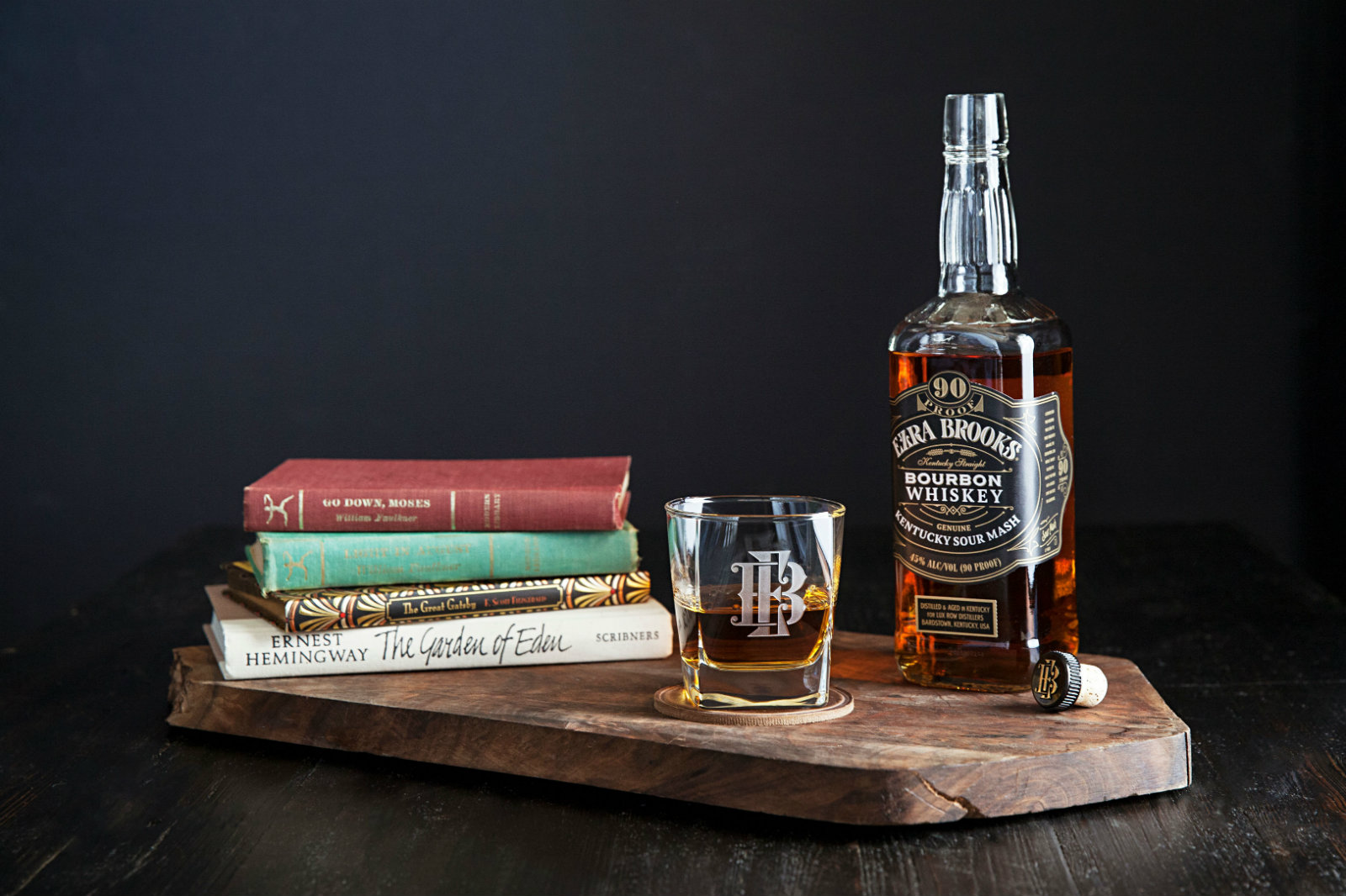 Ezra Brooks bourbon with stack of books