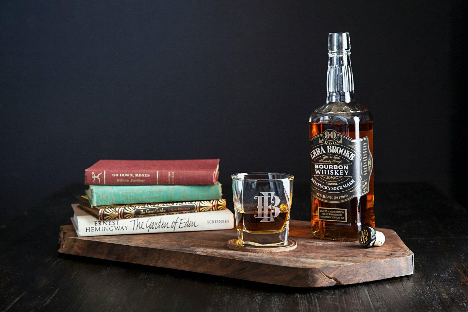 Ezra Brooks bourbon with stack of books